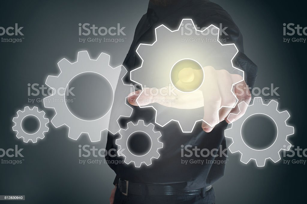 Touching gear / Touch screen concept (Click for more) stock photo