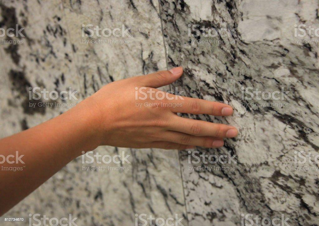 Touching Granite Stone stock photo