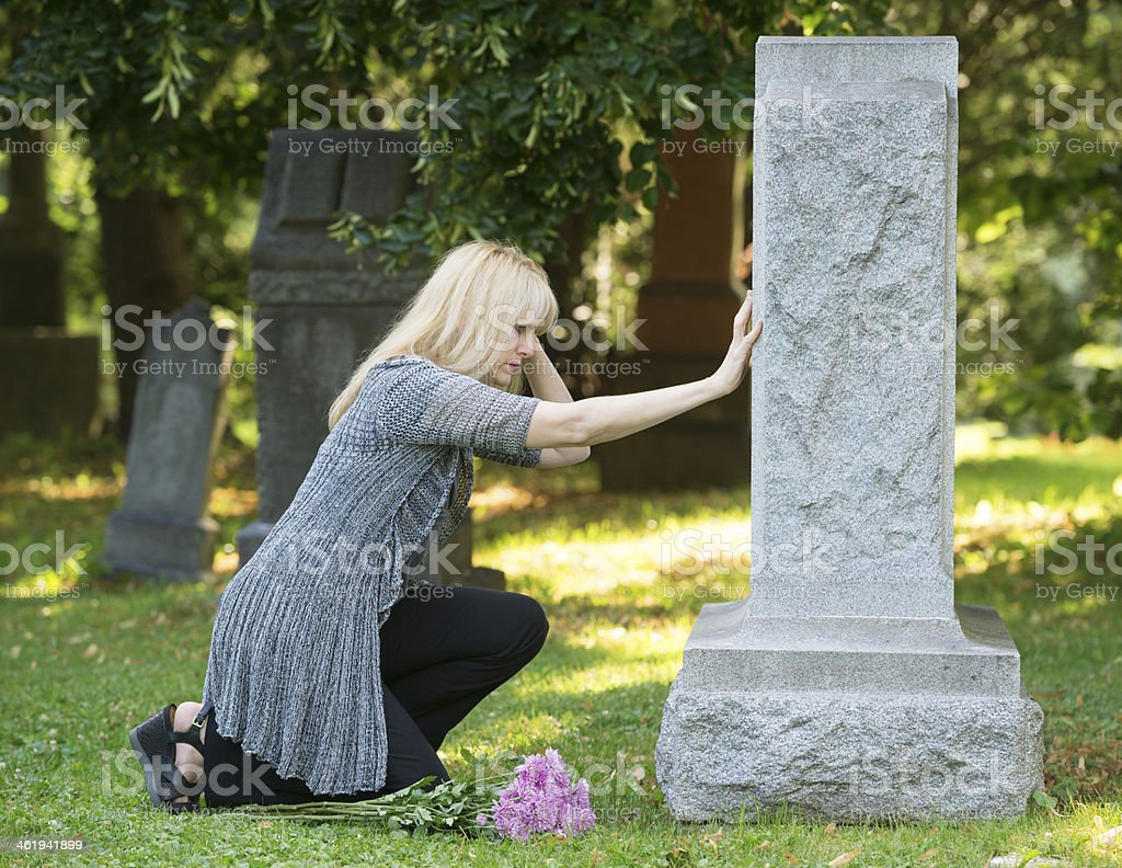 Touching Grief in the Cemetery stock photo