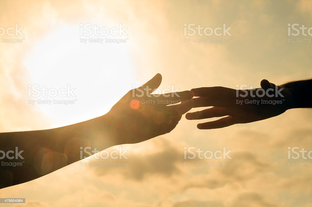 Touching hands stock photo