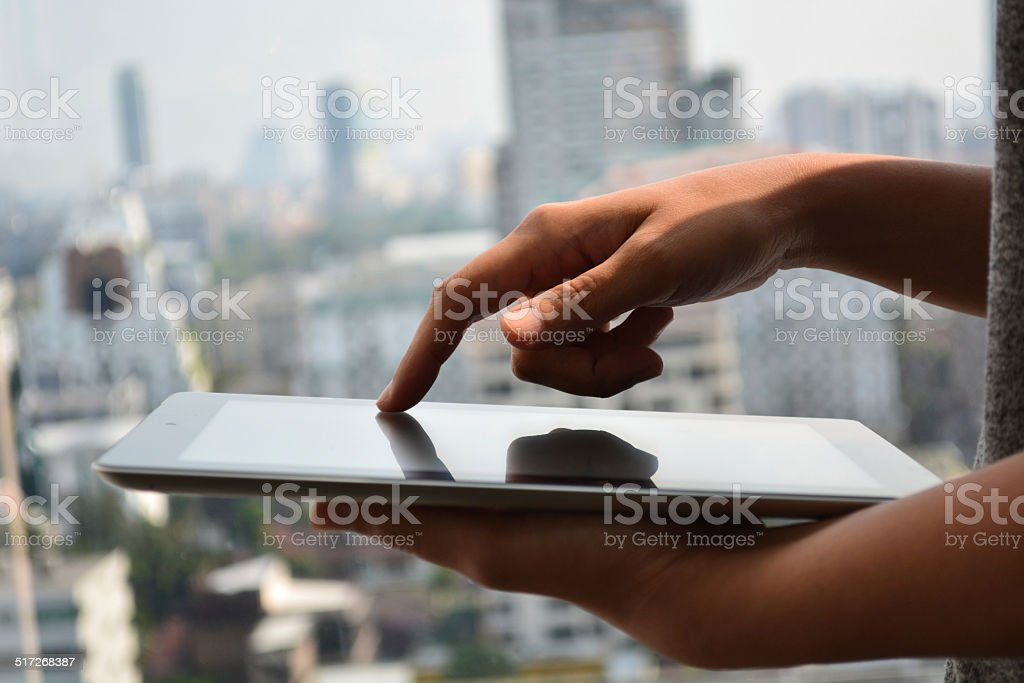 touching screen of a tablet computer stock photo
