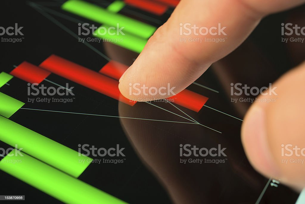touching screen of tablet pc with market graph royalty-free stock photo