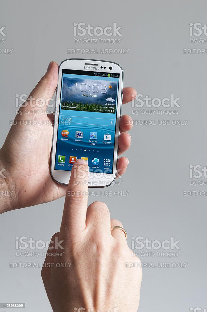 Touching screen on Samsung Galaxy SIII stock photo