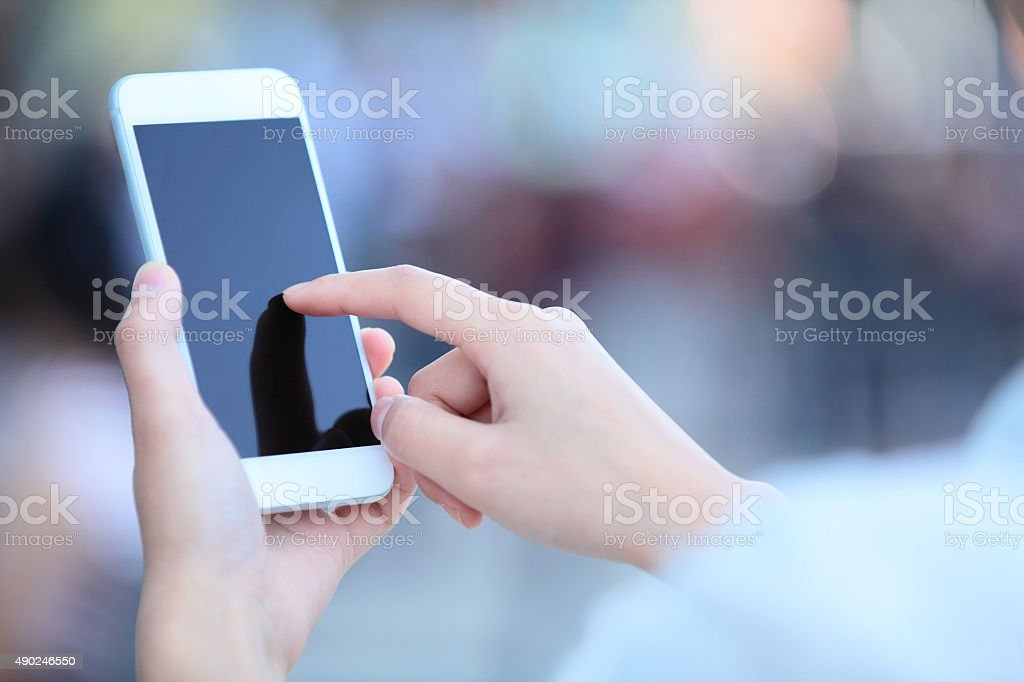 Touching Smart Phone stock photo