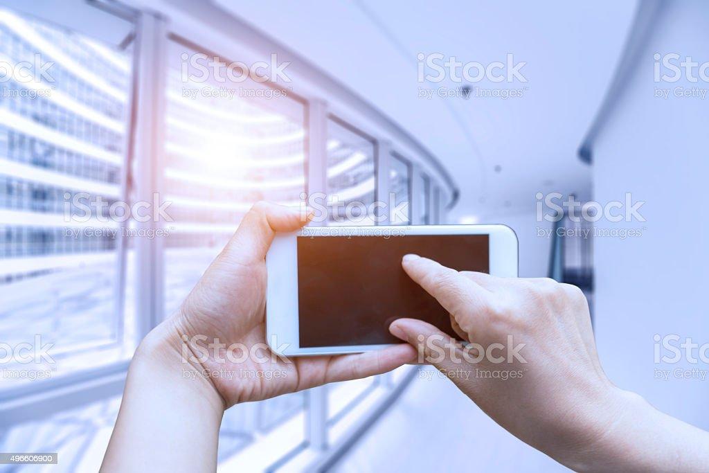 Touching smartphone stock photo