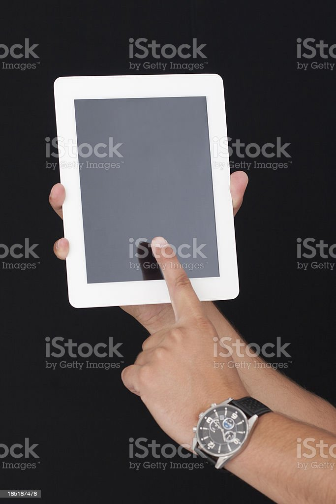 touching the digital tablet with index finger royalty-free stock photo
