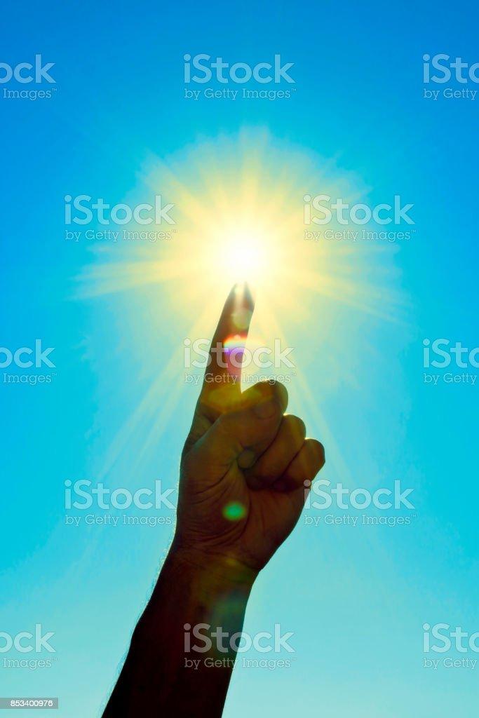Touching the sun stock photo
