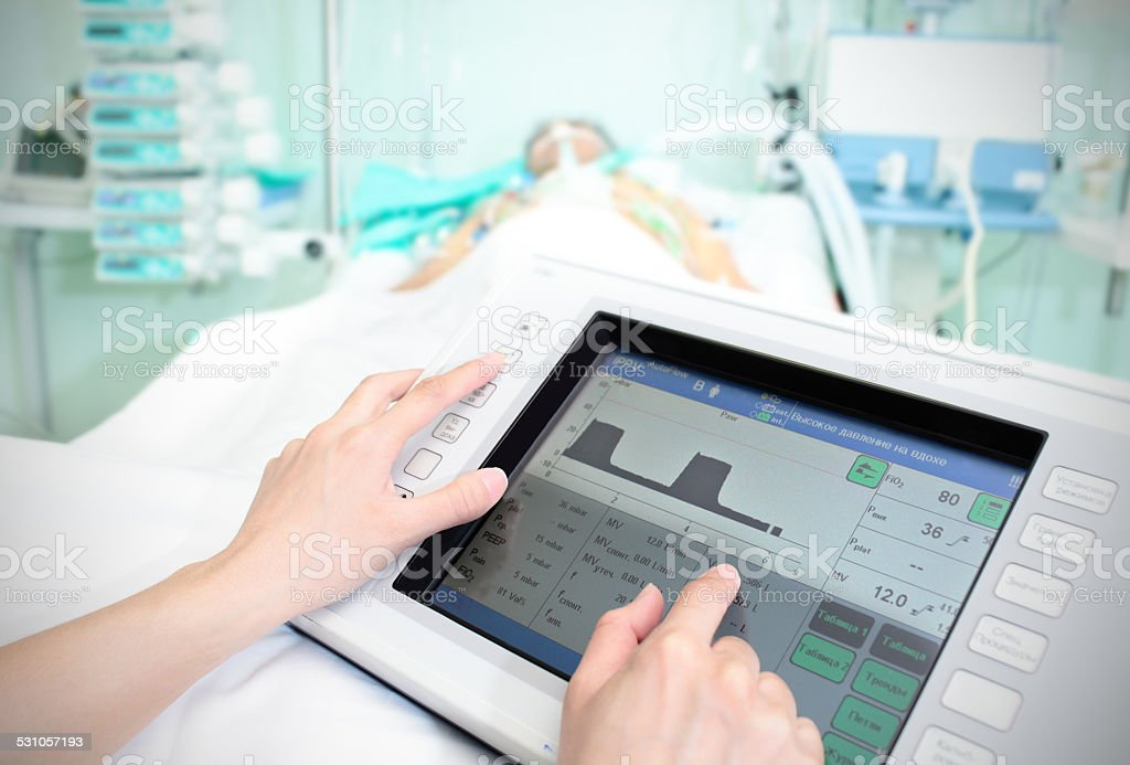 Touchpad in the hospital. The doctor adjusts the parameters stock photo