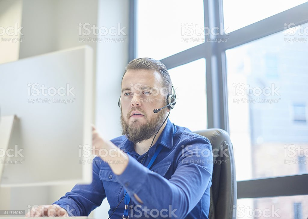 touchscreen call centre handler stock photo