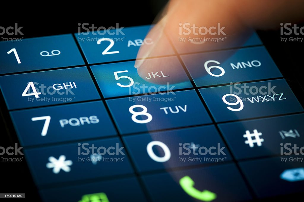 Touchscreen dialing pad on a smartphone stock photo