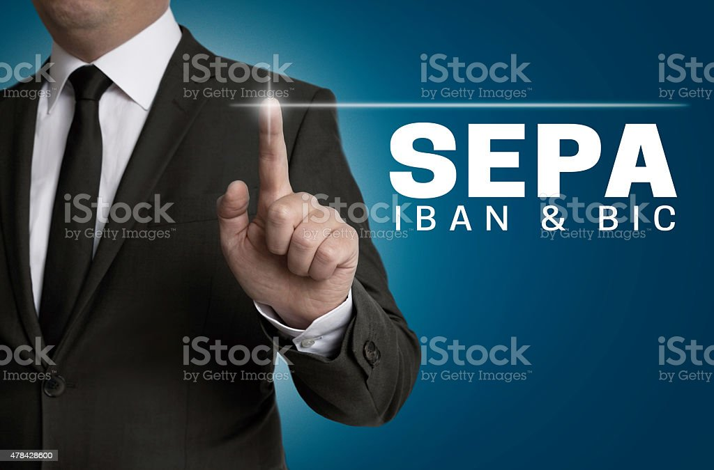 SEPA touchscreen is operated by businessman stock photo