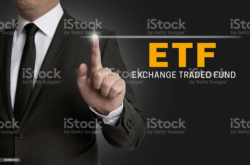 ETF touchscreen is operated by businessman stock photo