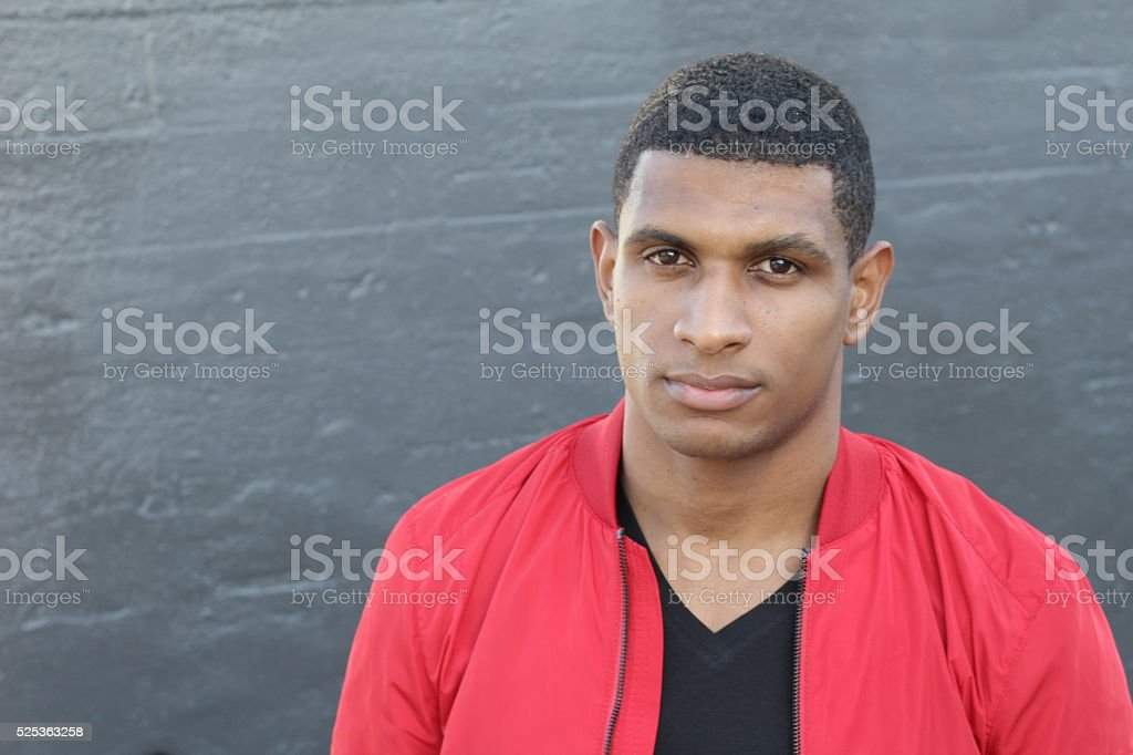 Tough African guy dressed in red and black stock photo