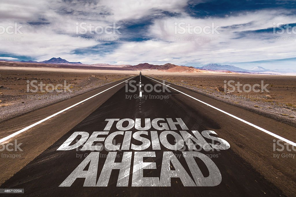 Tough Decisions Ahead written on desert road stock photo