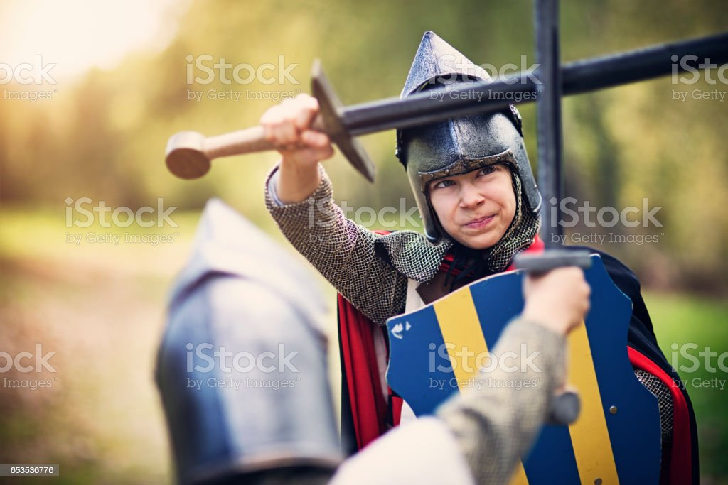 Tough girl knight fighting with enemy stock photo