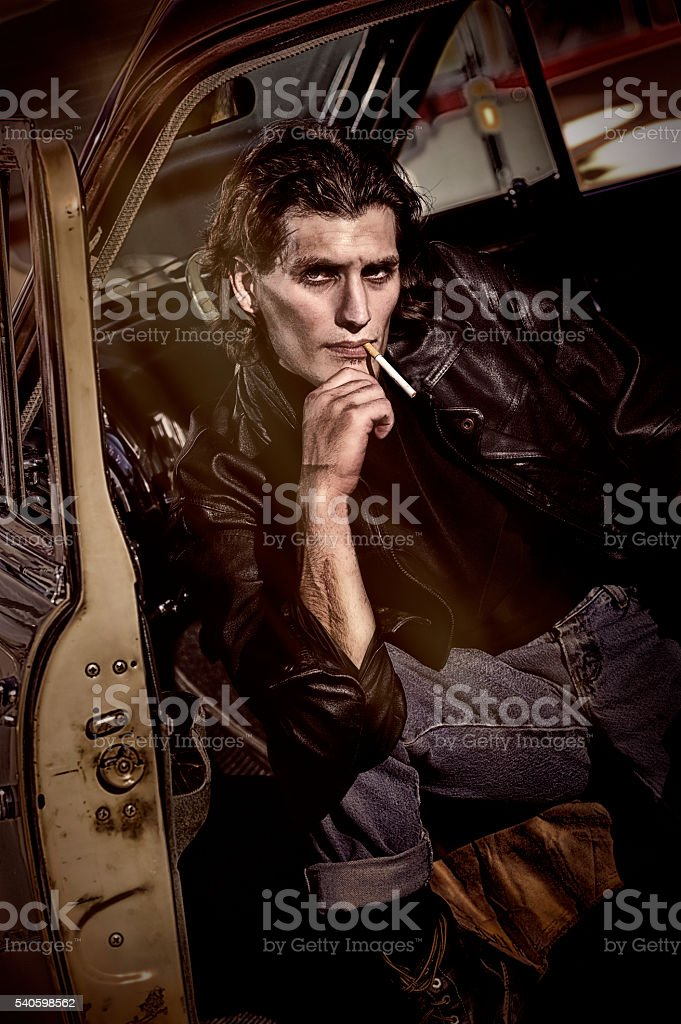 Tough Guy 1950's Man Smoking A Cigarette In His Car stock photo