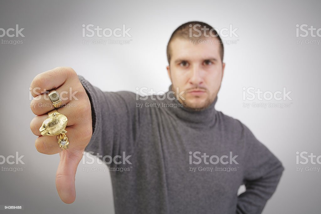 tough guy giving thumbs down royalty-free stock photo