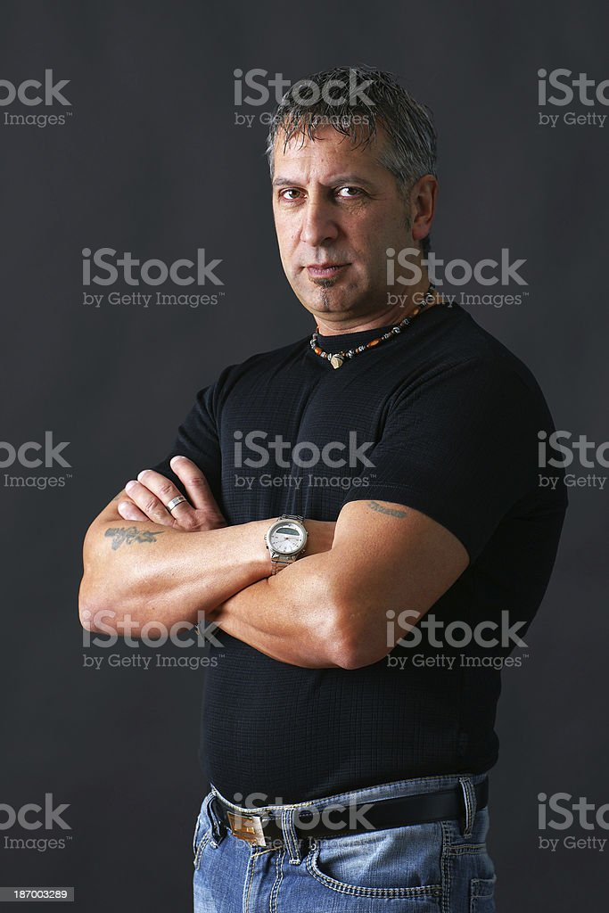 Tough guy looking at camera royalty-free stock photo
