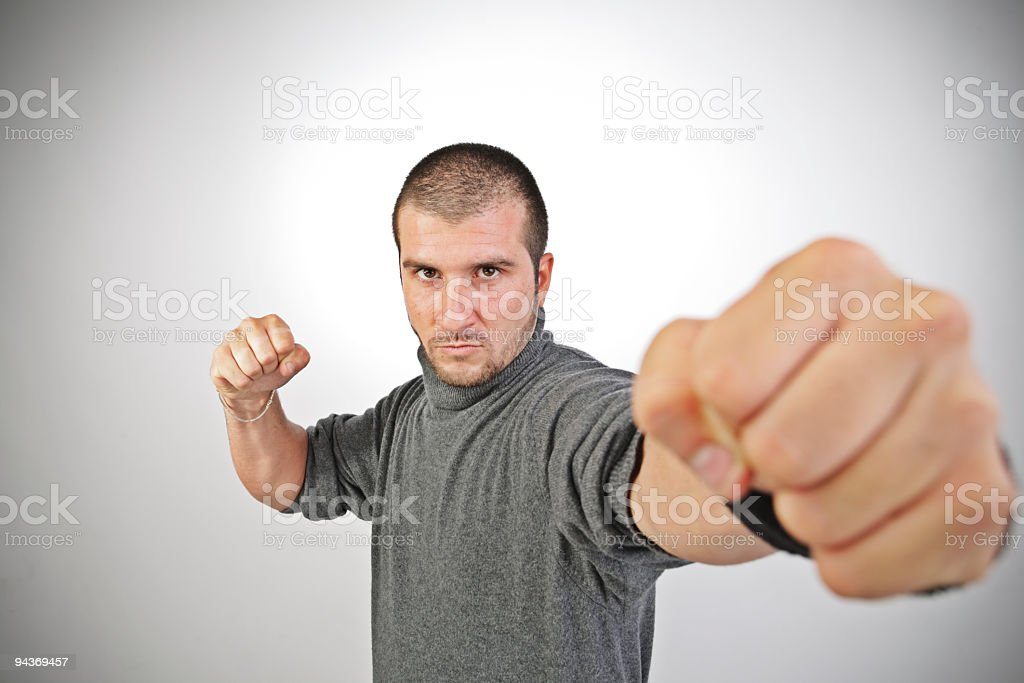 tough guy thorwing a punch royalty-free stock photo