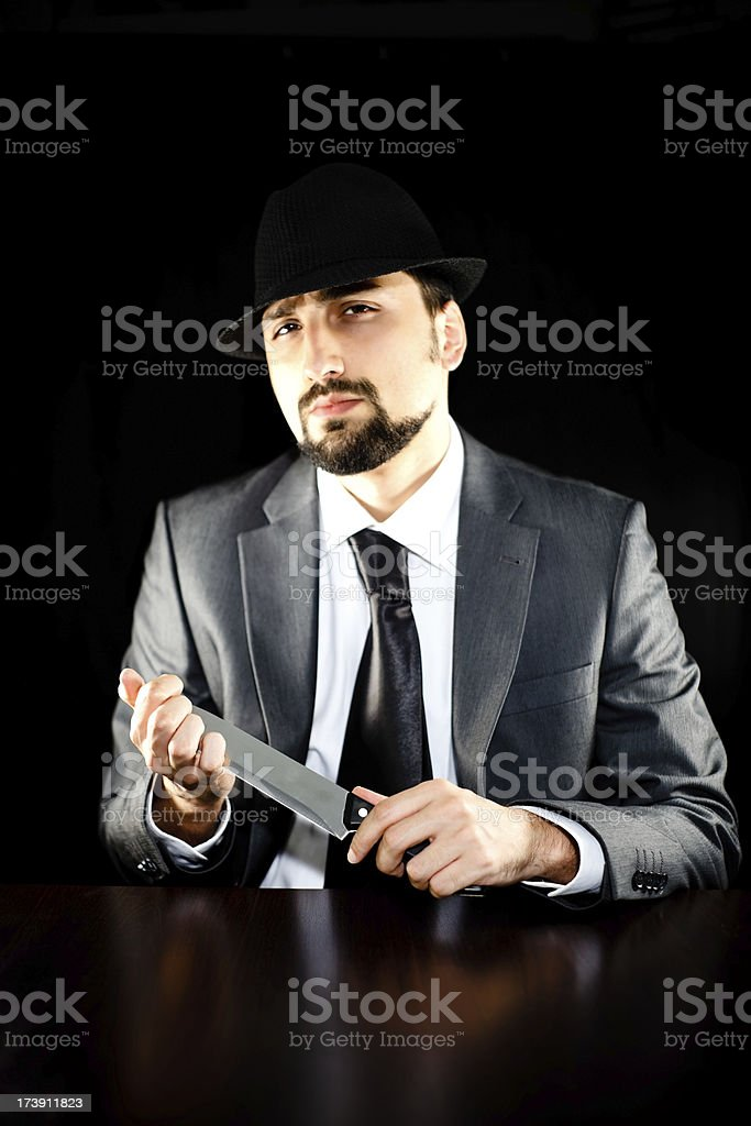 Tough guy with a knife stock photo