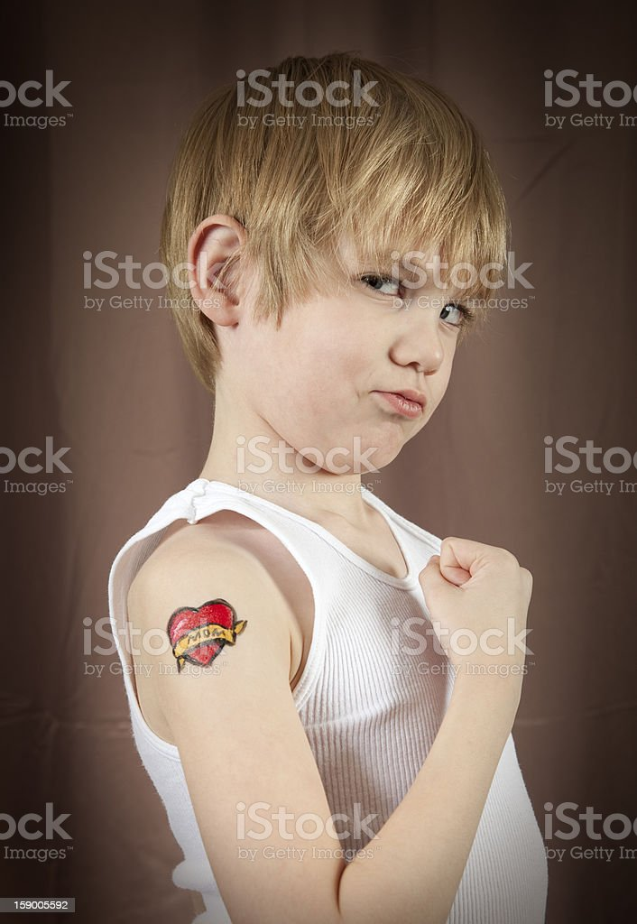 Tough Kid With Tattoo stock photo