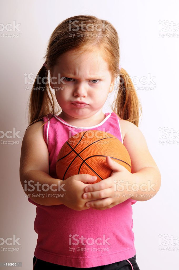 Tough Little Girl with Basketball royalty-free stock photo
