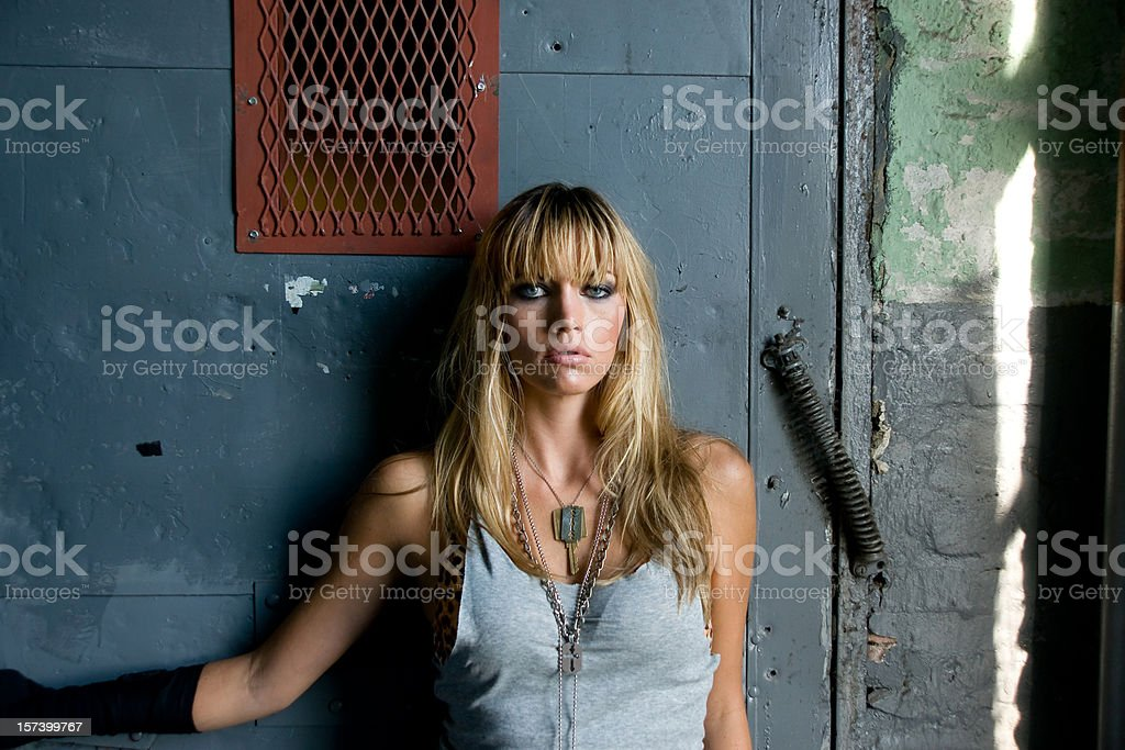 tough looking girl against industrial setting royalty-free stock photo