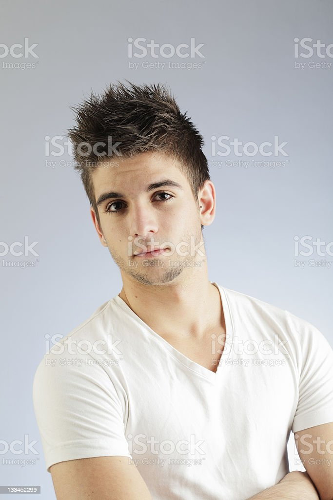 tough looking young man - vertical royalty-free stock photo