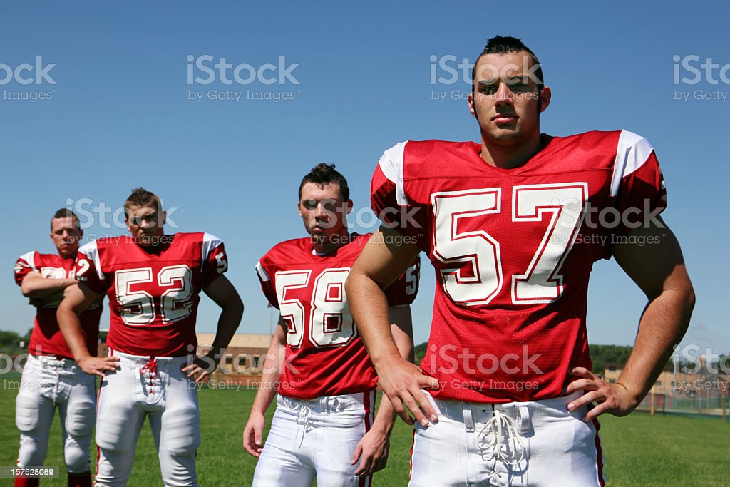 Tough, Macho Football Players royalty-free stock photo