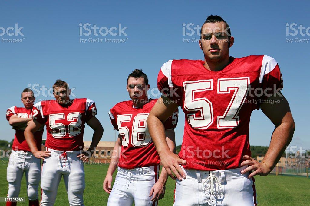 Tough, Macho Football Players stock photo