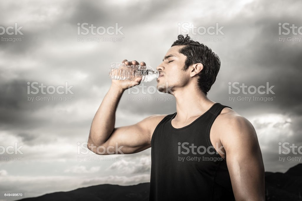 Tough Man Drinking Water stock photo
