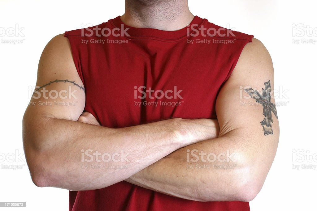 Tough man with tattoos and arms crossed. Bully. Red shirt. royalty-free stock photo