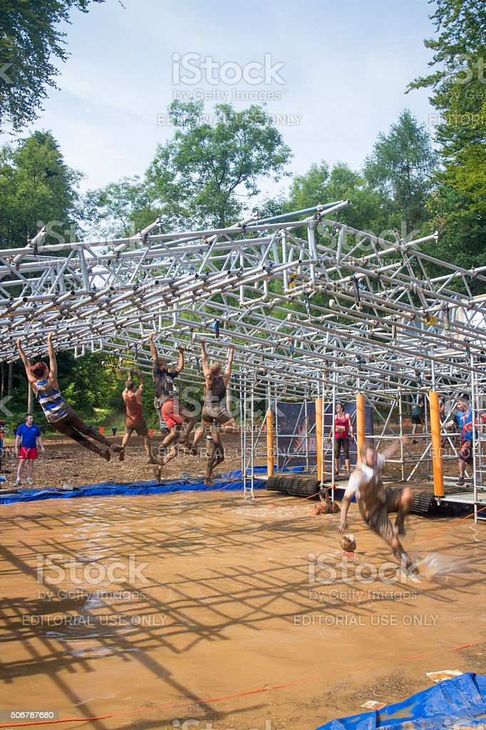 Tough Mudder competitors taking on the Monkey Bars stock photo