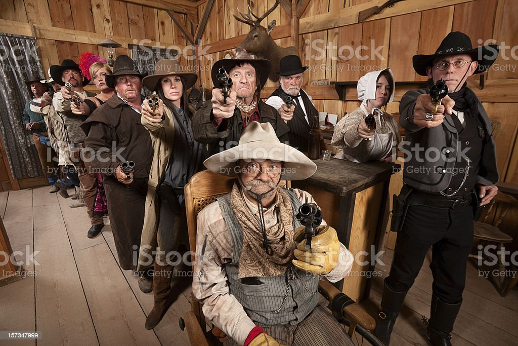 Tough People with Guns in Old Saloon royalty-free stock photo
