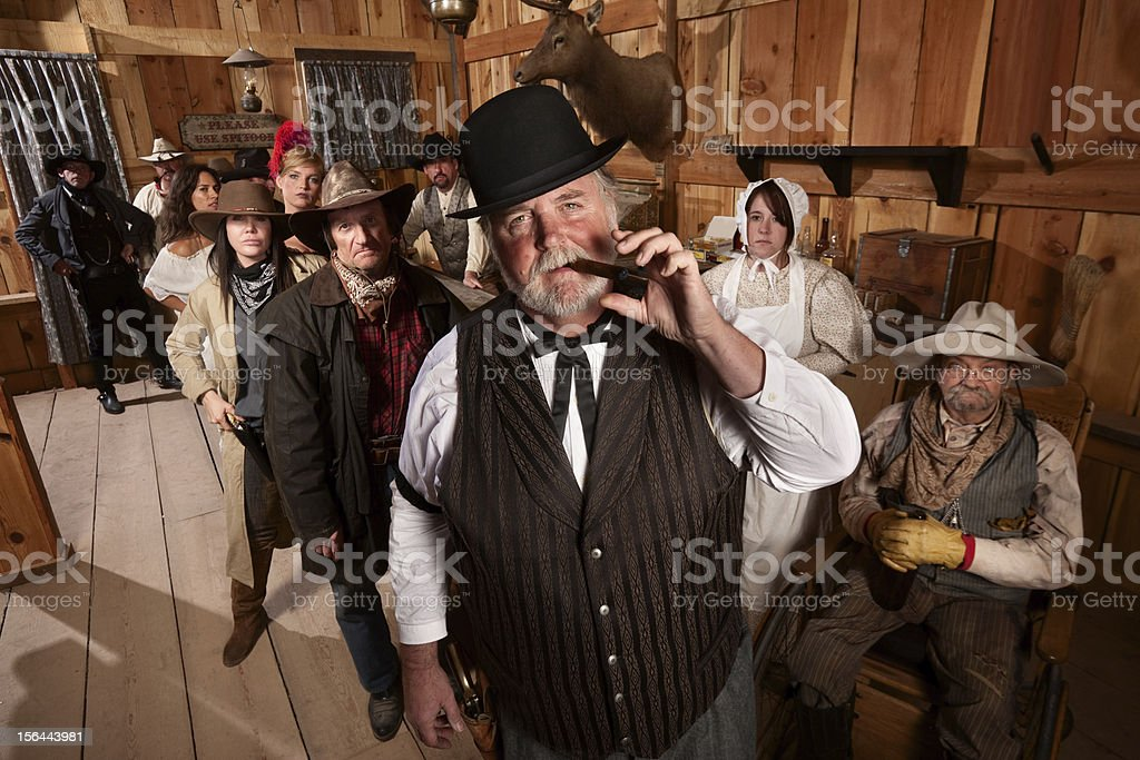 Tough Saloon Boss with Customers stock photo