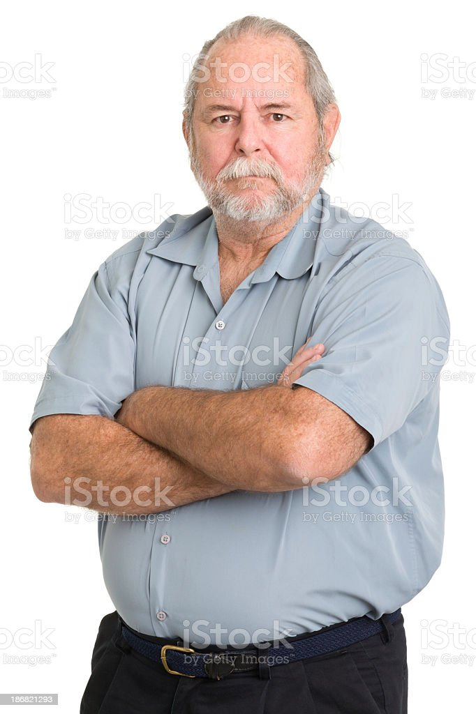 Tough senior man crossing his arms royalty-free stock photo
