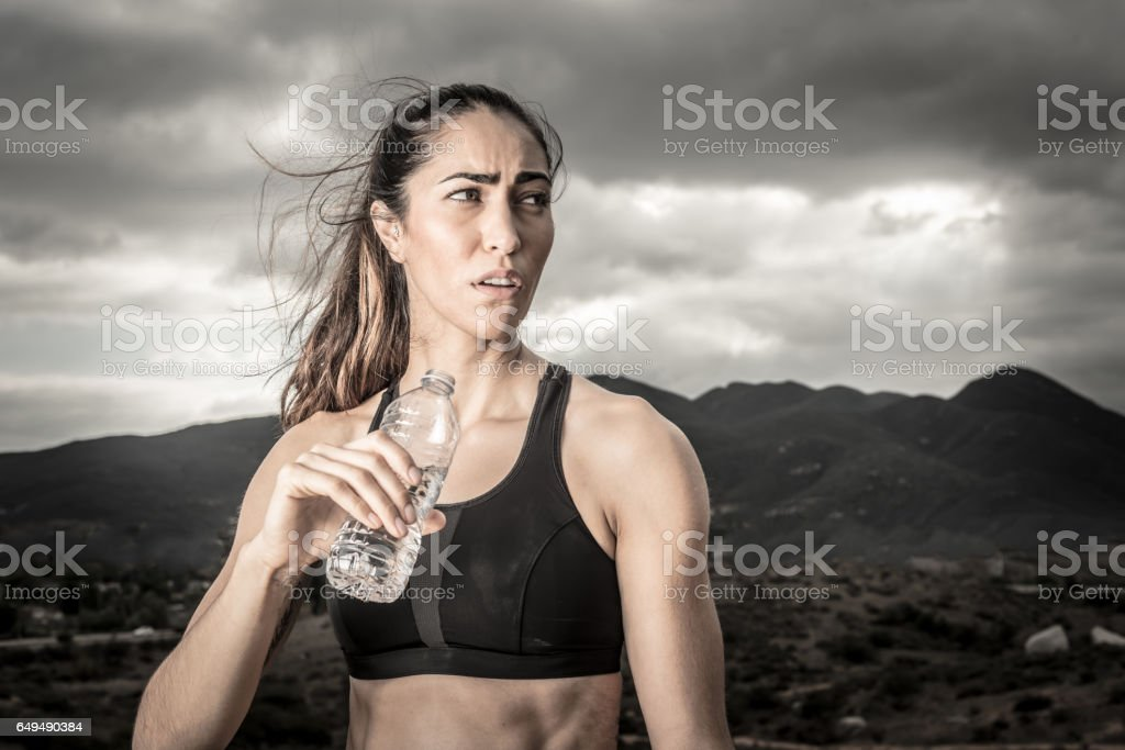 Tough Women Drinking Water stock photo