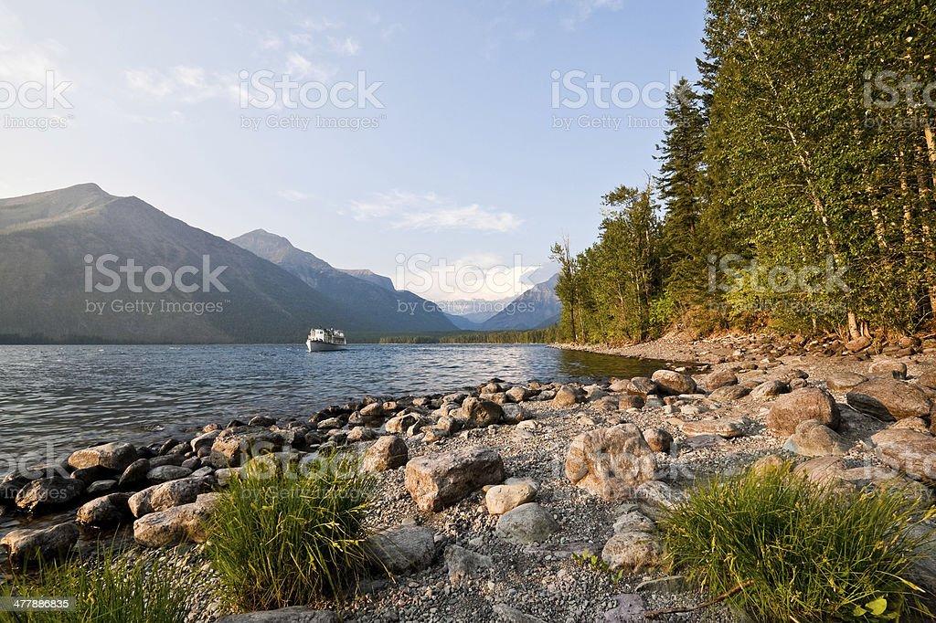Tour Boat Cruises the Shore of Lake McDonald royalty-free stock photo