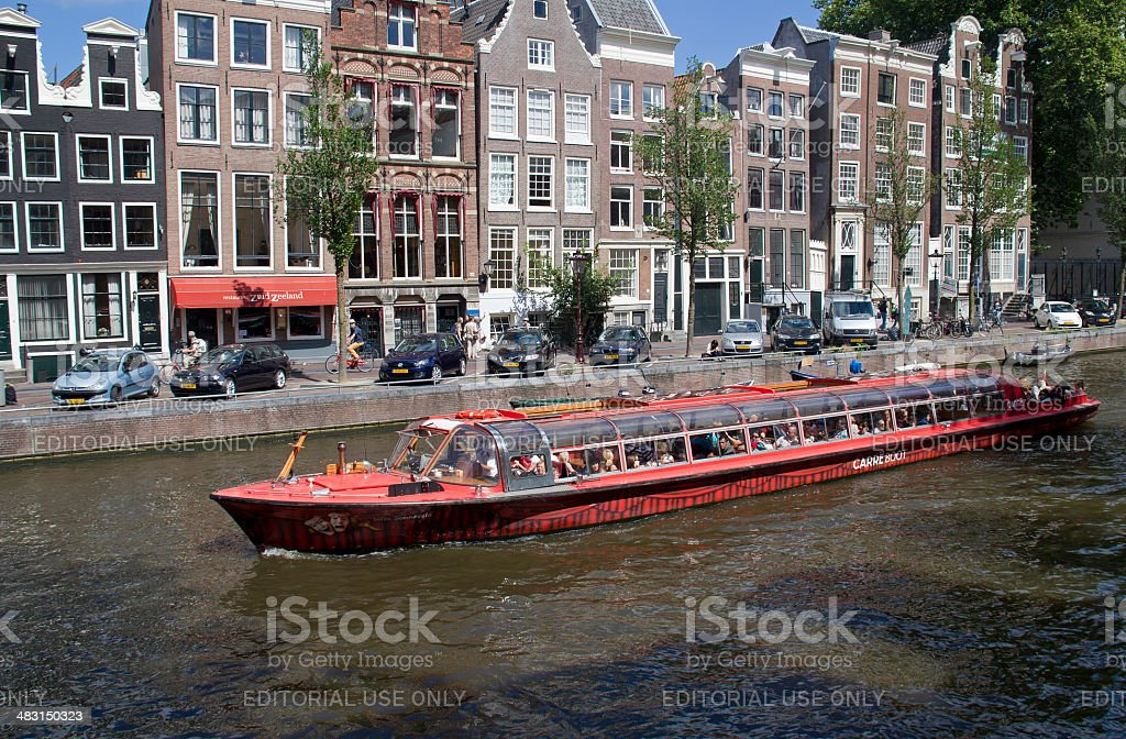 Tour boat in Amsterdam stock photo
