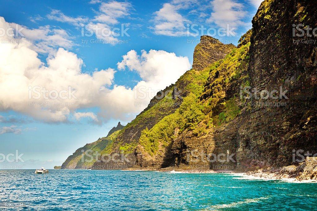 Tour Boat Touring the Na Pali Coast of Kauai Hawaii stock photo