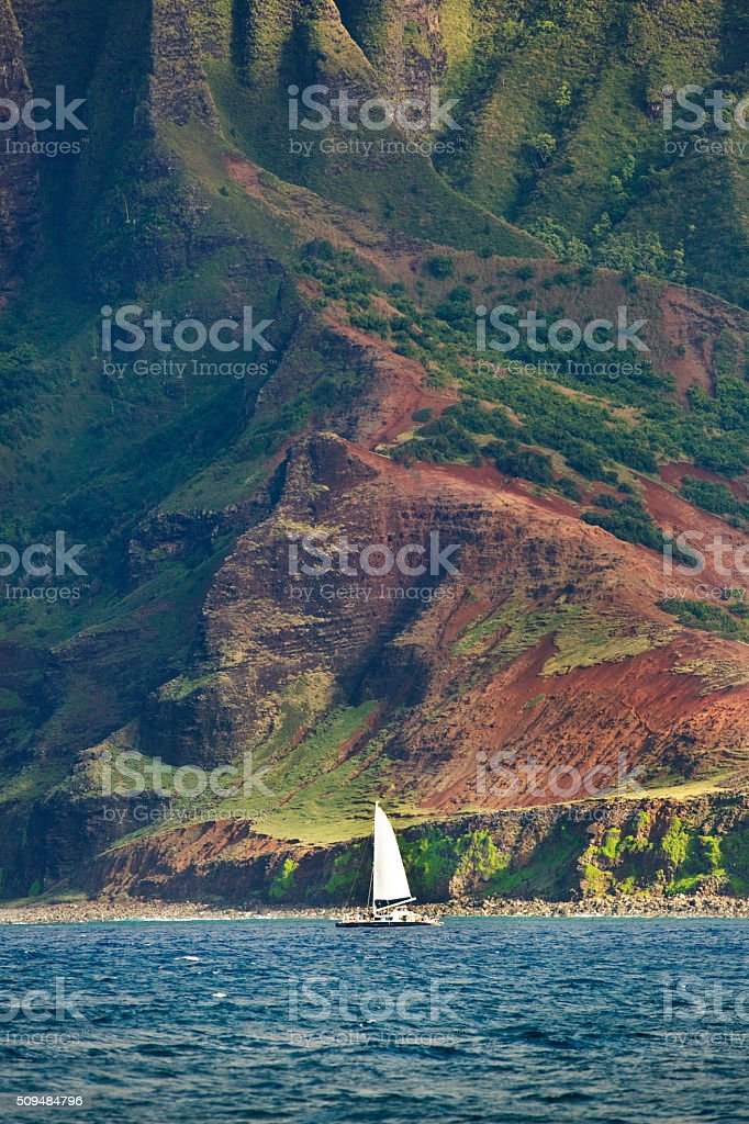 Tour Boat Touring the Na Pali Coast of Kauai stock photo