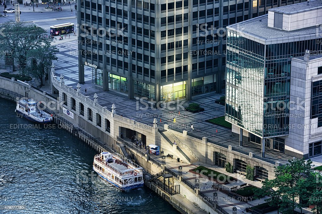 Tour boats moored at Pioneer Court on Chicago River stock photo