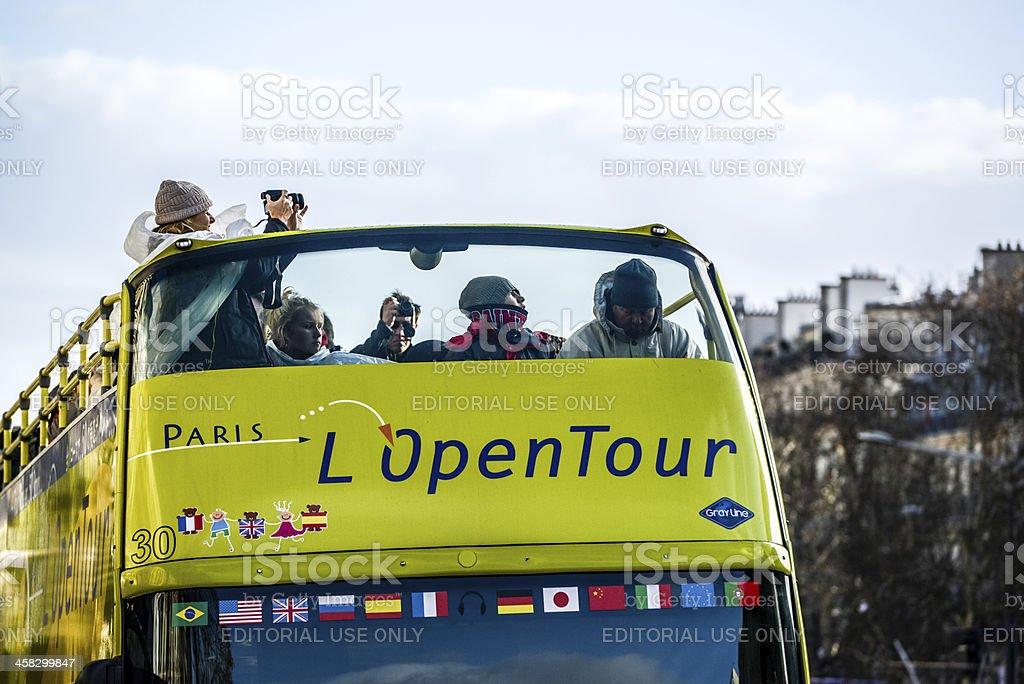 Tour Bus full of tourists on Paris street royalty-free stock photo