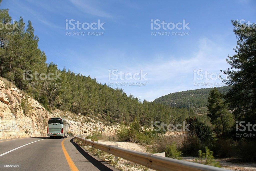 Tour bus on a mountain road royalty-free stock photo