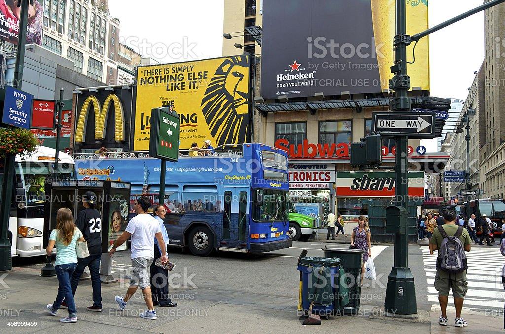 Tour bus, pedestrians, W.33rd St & 7th Ave., Manhattan, NYC stock photo