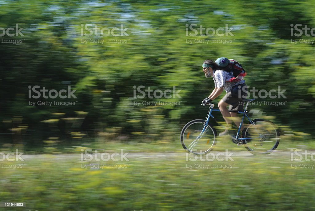 Tour cyclists moving in nature stock photo