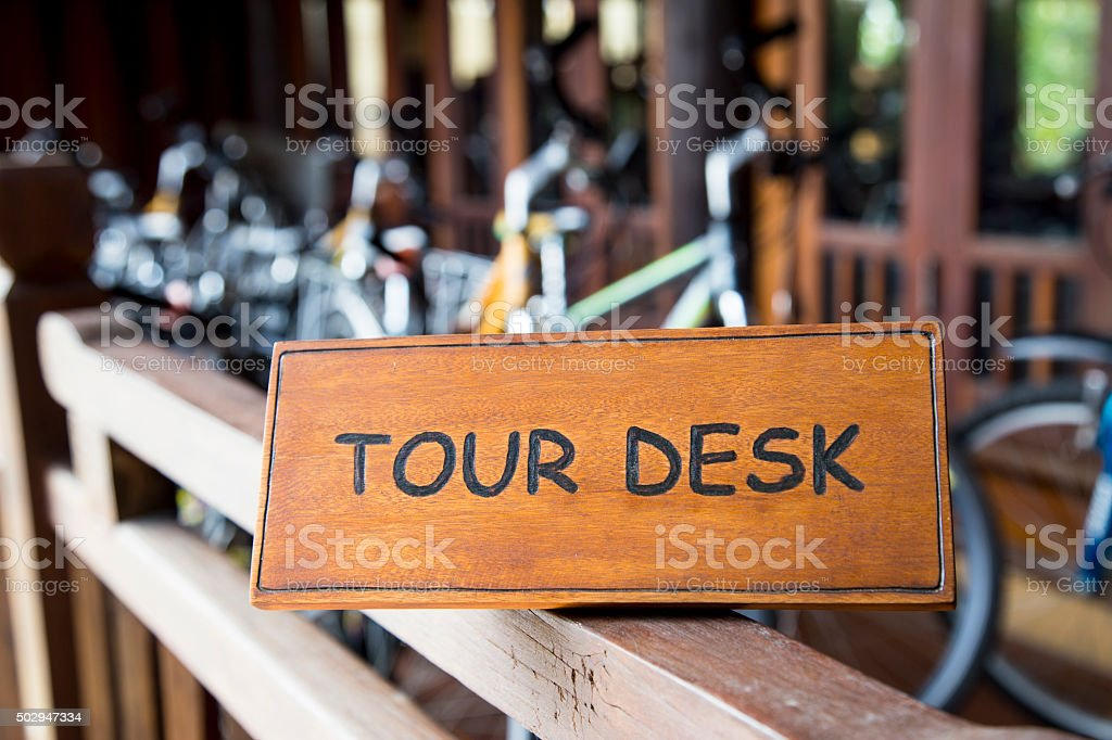 Tour desk sign stock photo