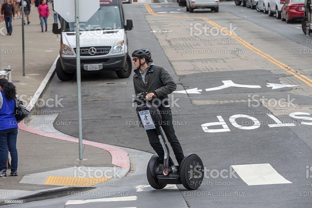 Tour guide running segway at San Francisco Downtown stock photo