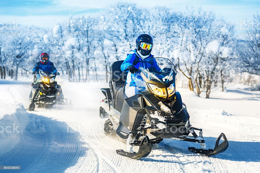Tour on snowmobile stock photo