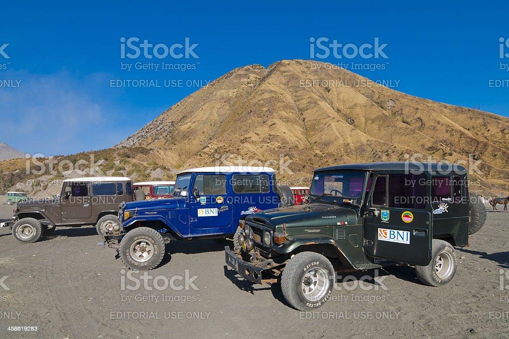 4WD tour vehicles wait at Mt Bromo stock photo